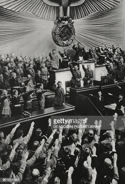 Adolf Hitler being saluted during an extraordinary session of the Reichstag at the Kroll Oper in Berlin Germany from L'Illustrazione Italiana Year...