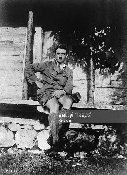Adolf Hitler Chancellor of Germany from 1933 on the porch of a rustic cabin circa 1930