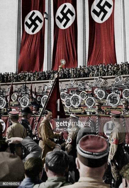 Adolf Hitler dedicates new standards Nuremberg Rally Germany 1934 Hitler at the 6th Nazi Party Congress A print from Adolf Hitler Bilder aus dem...
