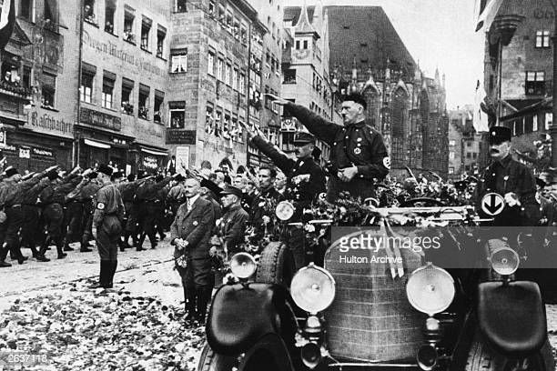 Adolf Hitler drives through the streets of Nuremberg during the third day of the National Socialist German Workers' party conference Germany Awakes...