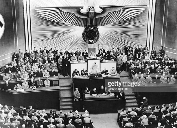 Adolf Hitler during his speech in the KrollOper beside the speakers desk to the right Otto Dietrich Wilhelm Brueckner to the left Hans Heinrich...