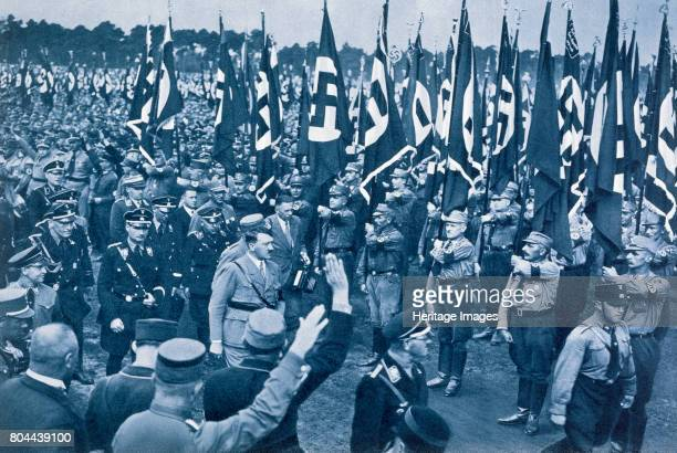 Adolf Hitler escorted by SS leaders inspects the SA on a Nazi Party Loyalty Day in Nuremberg 1933 From Deutsche Gedenkhalle Das Neue Deutschland...