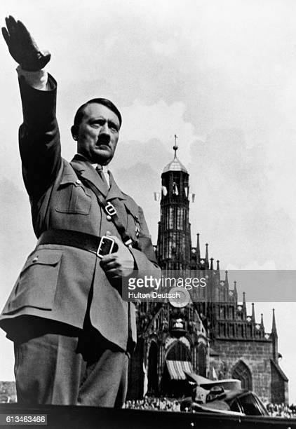 Adolf Hitler gives the Nazi salute at a party congress Germany