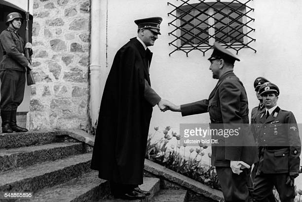 Adolf Hitler greeting the croatian head of state Dr Ante Pavelic at his mountain lodge in the Obersalzberg region near Berchtesgaden right Hitler's...