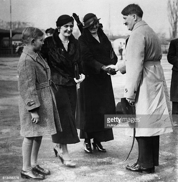 Adolf Hitler greets his sister at Templehofer airfield