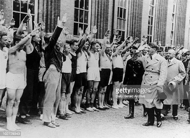 Adolf Hitler inspecting athletes Germany 1933 'Adolf Hitler inspecting some of the 600 athletes from all over Germany who are training for the...