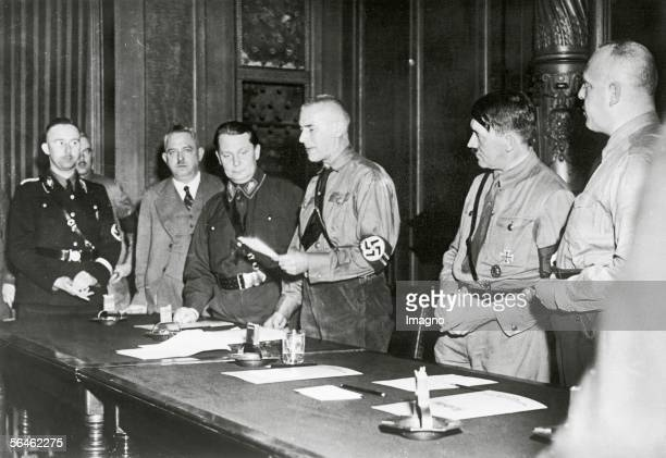 Adolf Hitler is swearing in the national socialist members of parliament Chairman of the party Wilhelm Frick opens the meeting Adolf Hitler and...