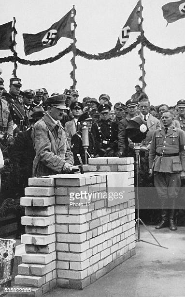 Adolf Hitler laying the first stone of a common house built on the 'AdolfHitlerKoog' in the SchleswigHolstein region Weimar Republic
