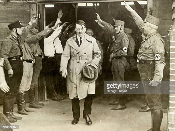 Adolf Hitler, leader of the Nationalist Socialists, photographed exclusively as he emerged from the world famous brown house in Munich, Germany, the...