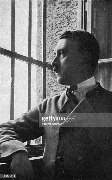Adolf Hitler looking out of a barred window in Landsberg jail where he dictated his autobiography Mein Kampf