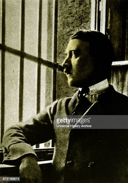 Adolf Hitler looking out of the bars on the window to his prison cell at Landsberg Prison In 1924 Adolf Hitler spent 264 days incarcerated in...