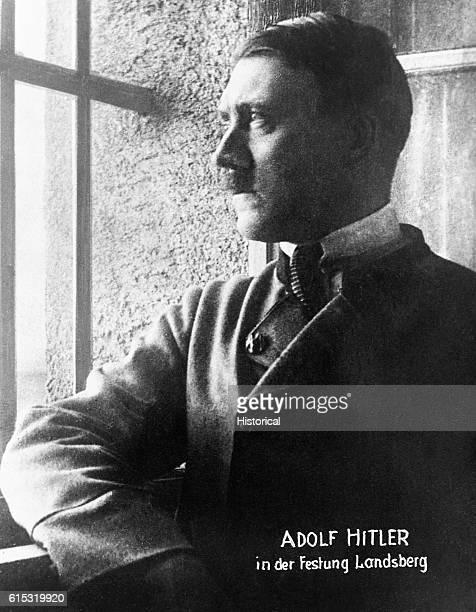 Adolf Hitler looks out a window in Landsberg am Lech prison in 1924
