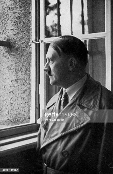 Adolf Hitler looks out of his cell window at Landsberg Fortress Bavaria Germany 1934 Hitler visiting the prison where he spent 8 months in 1924 for...