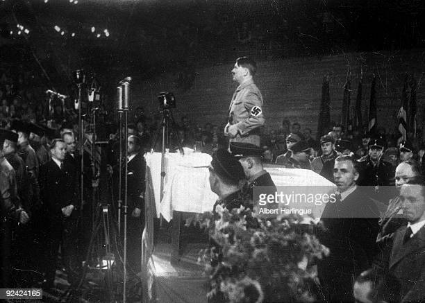 Adolf Hitler making a speech at the Sports stadium of Berlin on February 10 1933 On the bottom on the right is Goebbels