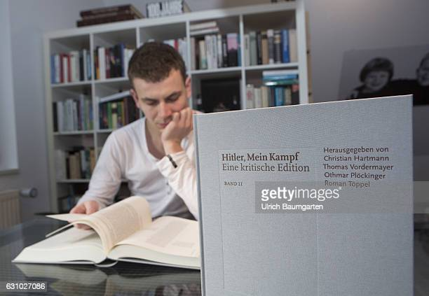 Adolf Hitler Mein Kampf Teenager reads in book 1 of the critical edition of the original book