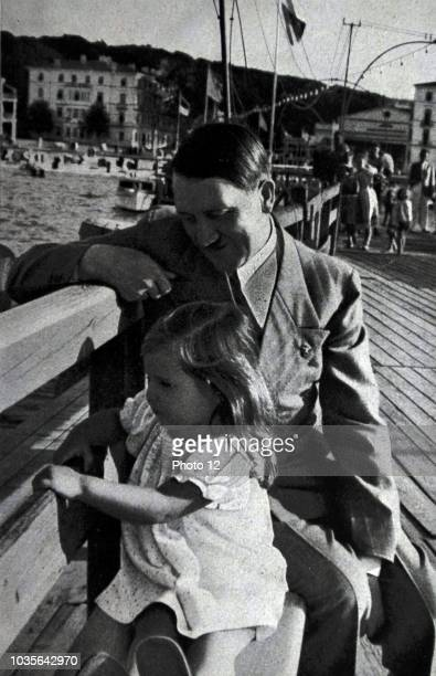 Adolf Hitler on a day at the coast accompanied by Helga daughter of Dr Josef Goebbels