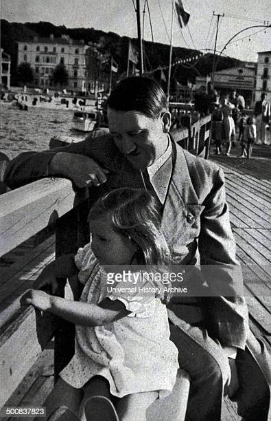 Adolf Hitler on a day at the coast, accompanied by Helga daughter of Dr Josef Goebbels