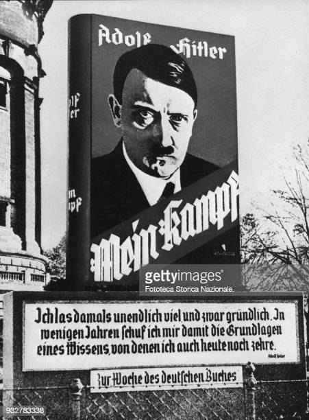 Adolf Hitler on an advertising poster of the 'Mein Kampf' on the streets of a German town The book that became the theoretical basis of Nazism was...