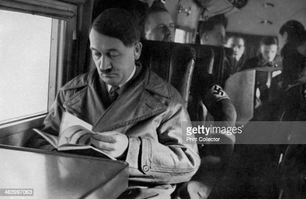 Adolf Hitler on an aeroplane 1936 Hitler reading a book during a flight A print from Adolf Hitler Bilder aus dem Leben des Führers Hamburg...