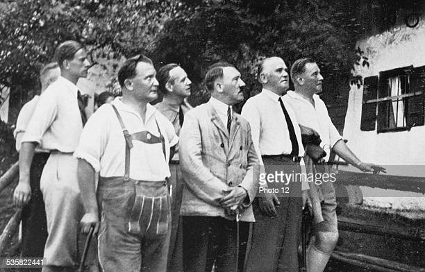 Adolf Hitler on holiday in Berchtesgaden Bavaria in front of the house where Dietrich Eckart lived several months in 1923 On his right Goering Weimar...