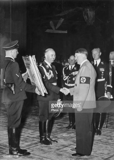 Adolf Hitler presented with a painting from SS Chief Heinrich Himmler circa 1937
