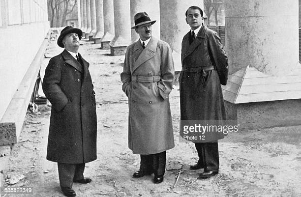Adolf Hitler professor Gall and architect Albert Speer visiting the building site of the Fine Arts House in Munich Weimar Republic