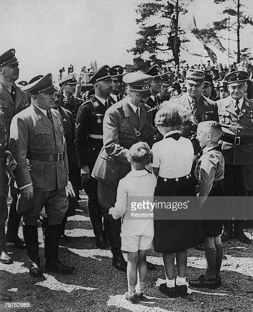 Adolf Hitler receives bouquets from children at the planned Volkswagen factory in Fallersleben where he is about to lay the foundation stone 27th May...