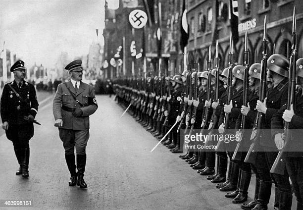 Adolf Hitler reviewing Leibstandarte troops at the Nuremberg Rally Germany 1935 Hitler inspecting soldiers of the Leibstandarte SS Adolf Hitler his...