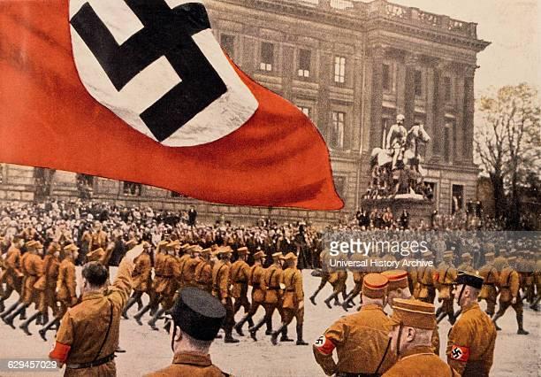 Adolf Hitler Saluting Marching Nazi Soldiers, Braunschweig, Germany, 1931.