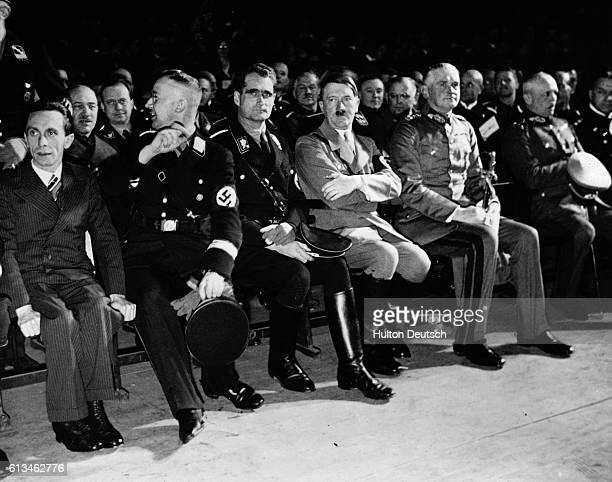 Adolf Hitler seated with Paul Goebells, Heinrich Himmler and Rudolf Hess at a pre-war conference in Berlin.