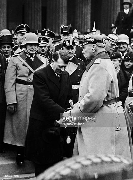 Adolf Hitler shakes hands with Paul Von Hindenburg President of the German Reich after being appointed to the Chancellorship