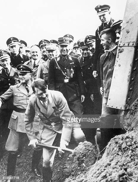 Adolf Hitler shovels dirt in Frankfurt breaking ground on the first German Autobahn