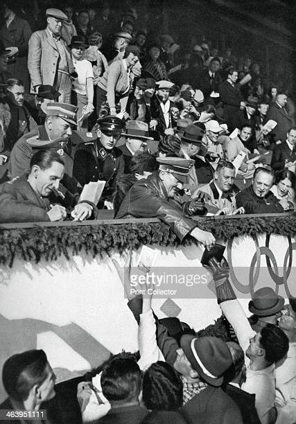 Adolf Hitler signs autographs, Winter Olympic Games, Garmisch-Partenkirchen, Germany, 1936. A print from Olympia 1936, Die Olympischen Spiele 1936,...