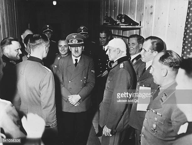 Adolf Hitler surrounded by his staff at his headquarters 'Wolfsschanze' near Rastenburg after the assassination attempt on July 20 1944 To the right...