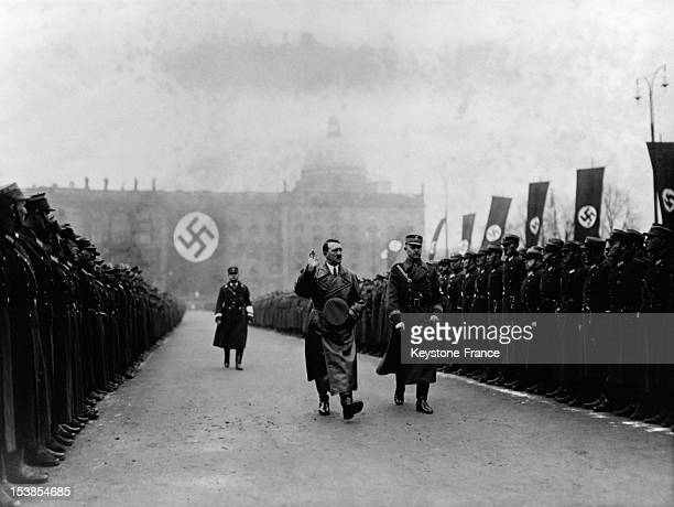Adolf Hitler taking the salute with Viktor Lutze during a SA detachment in 1936 in Berlin Germany