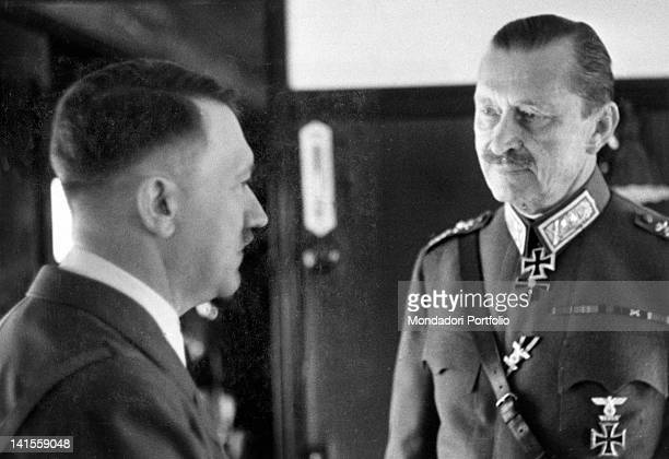 Adolf Hitler talking to the Finnish marshal Carl Gustaf Mannerheim during a visit to the Finnish headquarters at Leningrad present Saint Petersburg...