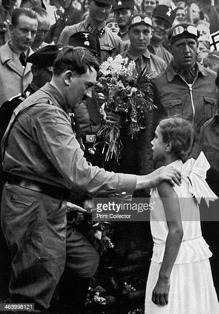 Adolf Hitler talking with a young girl during his election campaign 1932 Hitler finished second to Paul von Hindenburg in the 1932 German...