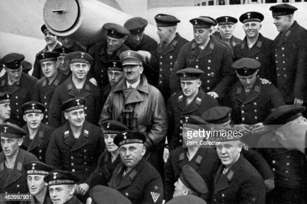 Adolf Hitler visiting a battleship Germany 1936 Hitler posing for a photograph with the crew A print from Adolf Hitler Bilder aus dem Leben des...