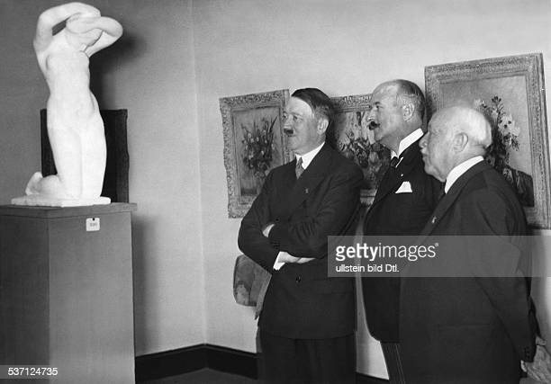 Adolf Hitler visiting an exhibition of french artists at the Pariser Platz in Berlin middle the french ambassador and high commisioner Andre...