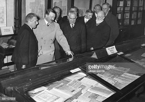 Adolf Hitler visiting the autograph collection of the Bavarian State Library 1936 Photographer PresseIllustrationen Heinrich Hoffmann Published by...