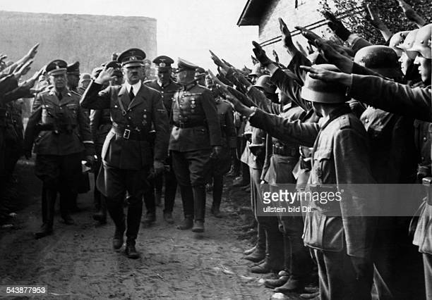 2 WW Adolf Hitler visiting troops Eastern Front Poland Adolf Hitler near Lodz surrounded by Wehrmacht soldiers greeting him with the Hitler salute...
