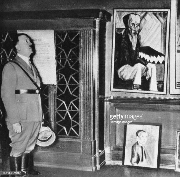 Adolf Hitler visits the Dresden exhibition Degenerate Art in 1935, 1935. Private Collection.