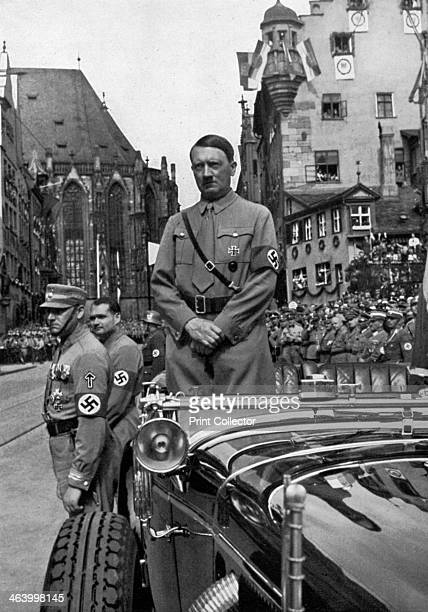 Adolf Hitler waiting for SA 'Brownshirts' Nuremberg Germany 1935 Hitler in Nuremberg for the 7th Party Congress named the 'Rally of Freedom' by the...