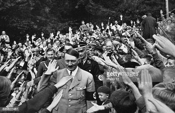 Adolf Hitler walking among the crowd of partisans in front of his country house in Obersalzberg Bavaria Weimar Republic
