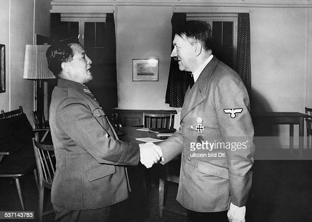Adolf Hitler welcoming Japanese ambassador Hiroshi Oshima at the Fuehrer's headquarters near Rastenburg in East Prussia , -