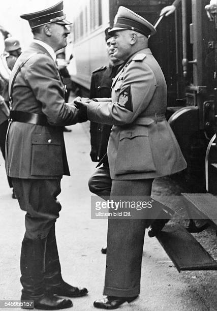 Adolf Hitler welcoming the Italian head of state Benito Mussolini at the main station in Kufstein Austria to drive with him to Munich