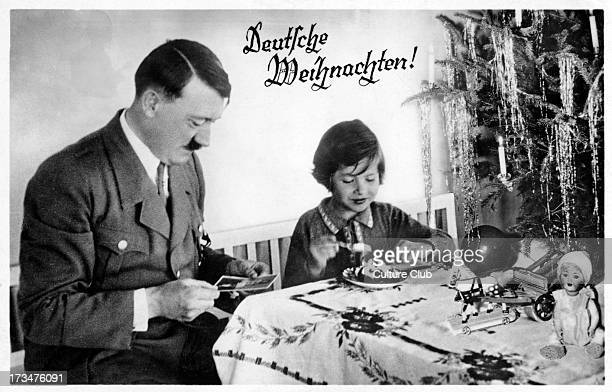 Adolf Hitler with a child Austrianborn German politician and the leader of the National Socialist German Workers Party 20 April 1889 – 30 April 1945...