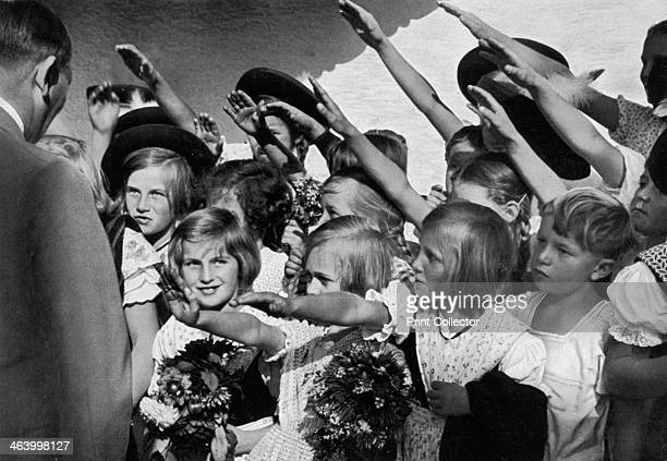 Adolf Hitler with a group of young children 1936 Hitler receiving the Nazi salute from a group of children A print from Adolf Hitler Bilder aus dem...
