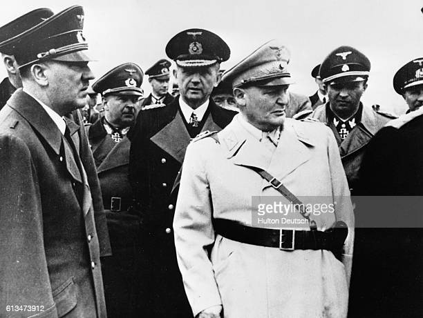 Adolf Hitler with Admiral Karl Doenitz and General Hermann Goering