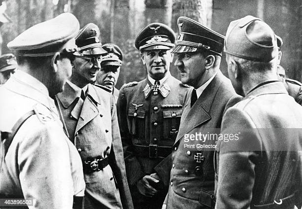 Adolf Hitler with Benito Mussolini and senior Nazis 1944 The photograph was taken after the unsuccessful attempt on Hitler's life on 20 July 1944...